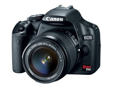 EOS 15.1 MP CMOS Digital SLR with 3-Inch LCD and EF-S 18-55IS - NEW TORN BOX